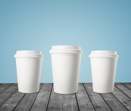 plastic cup: three cup of coffee on wood table