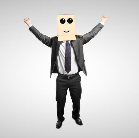 happy man with a box on head with smile Stock Photo - 18187852