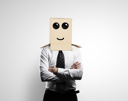 businessman with a box on head with smile Stock Photo - 18187986