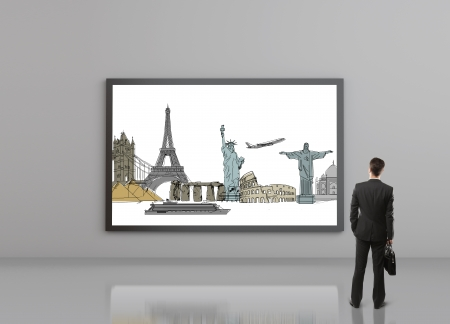 man looking at traveling on billboard photo