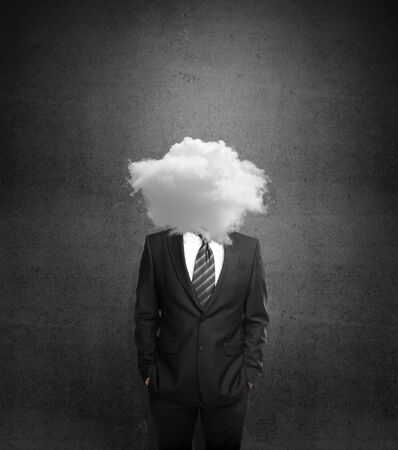 persuasion: businessman with cloud head on gray background Stock Photo