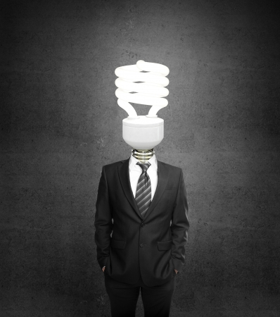 male costume: man standing with lighbulb in head
