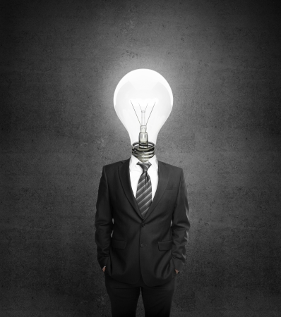 male costume: businessman with lamp head on gray background