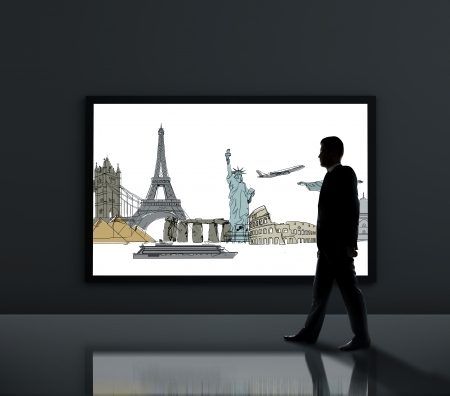 businessman walking past a large poster with traveling photo