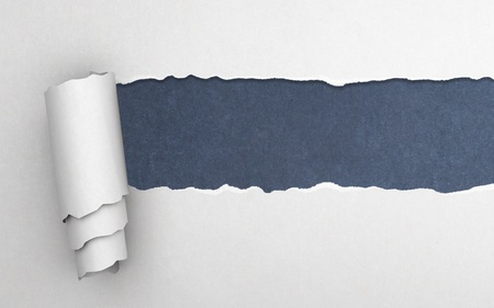 torn edge: Torn paper with blue background Stock Photo