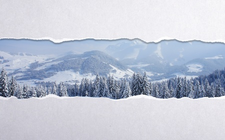 torn paper with winter landscape background photo