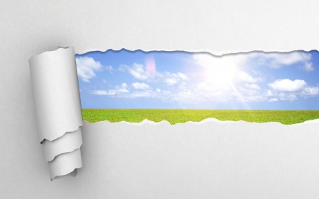 white torn paper with sky background photo