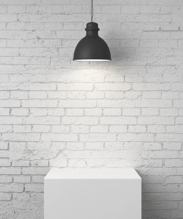 plafond: white brick room with podium and lamp Stock Photo