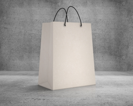 brown shopping bag on a concrete background photo