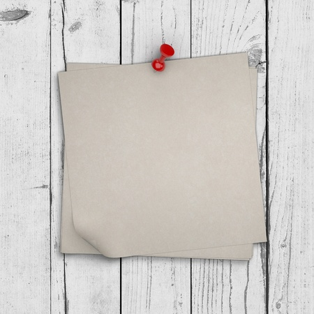 note paper pinned on white wooden wall photo