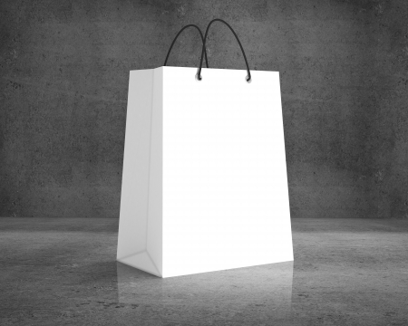 brown paper bags: white shopping bag on a concrete background Stock Photo