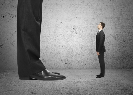 bankers: big foot and small  businessman
