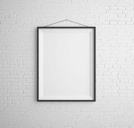 frame on wall: cornici nere sul muro di mattoni