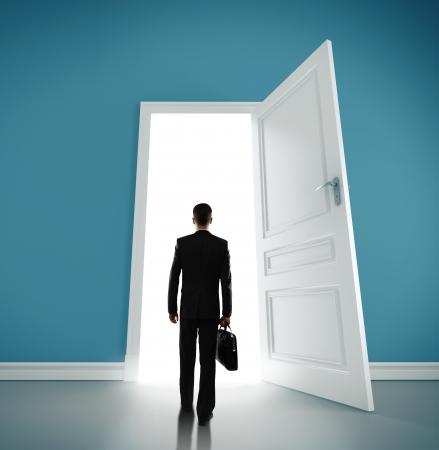 man in blue room with doors open Stock Photo - 18324839