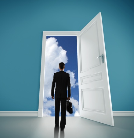 man with briefcase open door to blue scy Stock Photo - 18324962