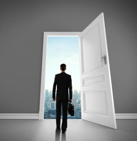 man with briefcase open door to city Stock Photo - 18325018