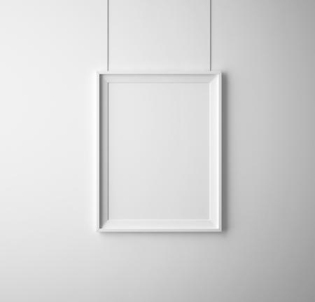 retratos: cartel de papel en blanco en la pared blanca Foto de archivo