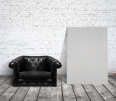 chair in room and blank cardboard photo