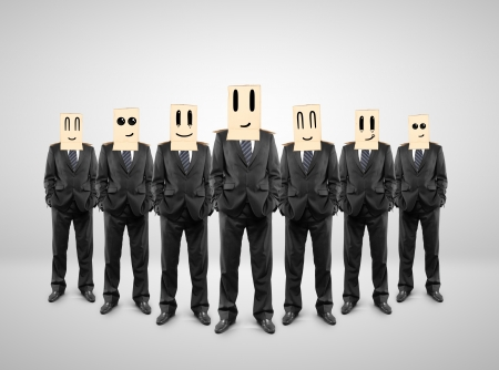 hidden success: group of businessman with a box on head with smile