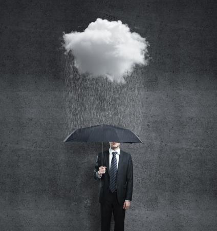 umbrella rain: businessman with umbrella and rain Stock Photo