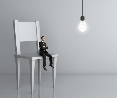 executive chair: little man sitting a big chair and lamp