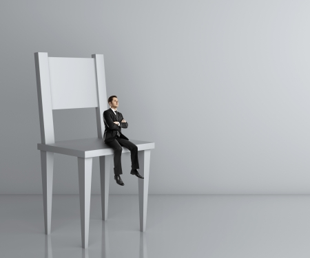 man in chair: man sitting a big chair Stock Photo