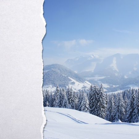 textured paper background: torn paper with winter landscape background Stock Photo
