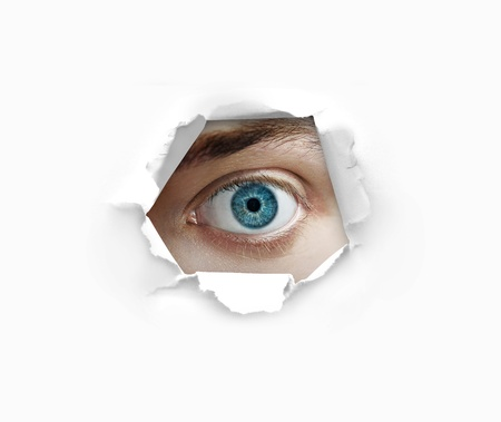 eye hole: Eye looking through a hole in paper