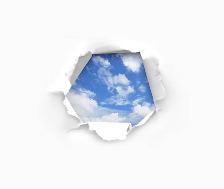 grey skies: blue sky through a hole in paper