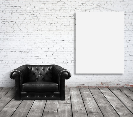 cement wall: chair in room and blank poster on wall