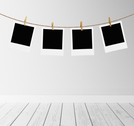 photos hanging on a rope in room photo