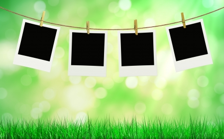 photos hanging on a rope and summer background photo