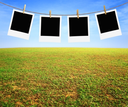 four photos hanging on a rope and nature  background photo