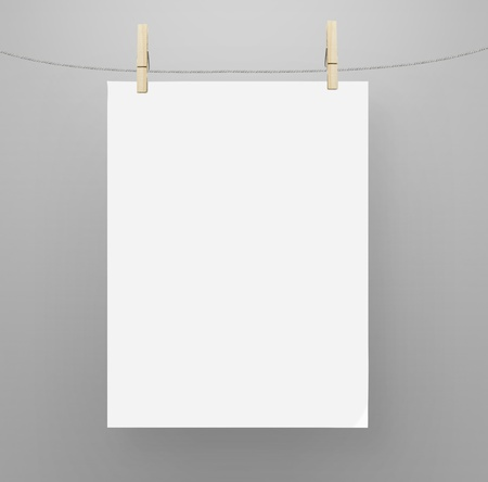 paper clips: poster hanging on a rope Stock Photo