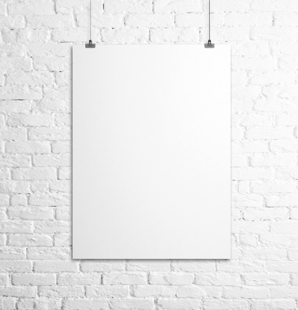 gallery wall: poster hanging on a rope and brick wall Stock Photo