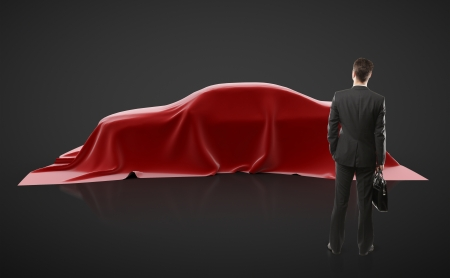 businessman looking on red car presentation photo