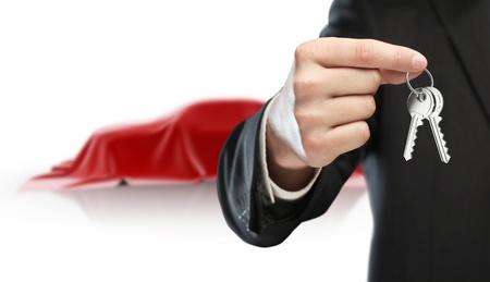 hand key: businessman holding keys and  red car presentation