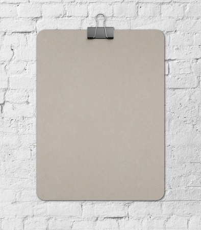 blank clipboard on a brick wall background photo