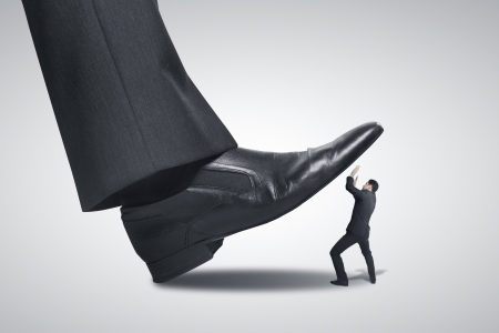 big foot stepping on businessman photo