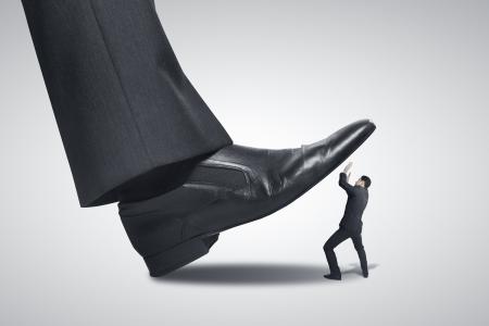 banker: big foot stepping on businessman