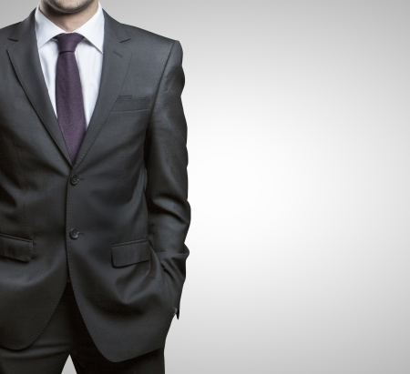 gray suit: businessman in suit on a gray background Stock Photo