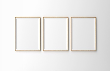 gallery wall: three wooden frames on white wall Stock Photo