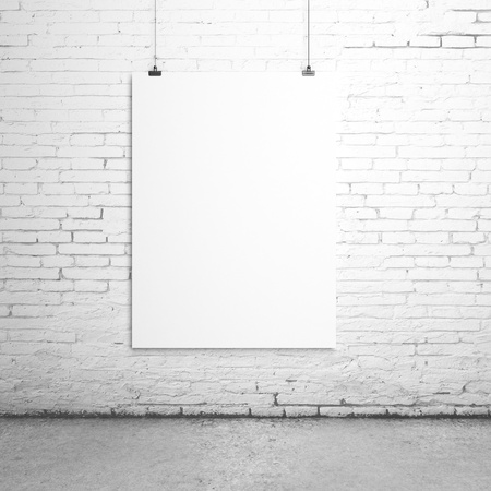 poster wall: white blank paper clips on brick room