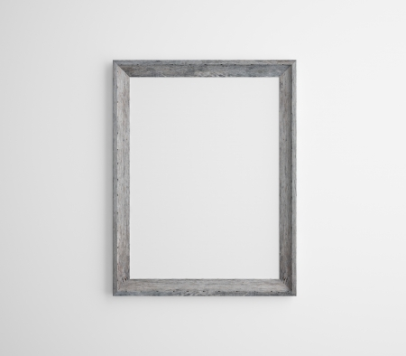 picture frame on wall: wood frame on a white wall