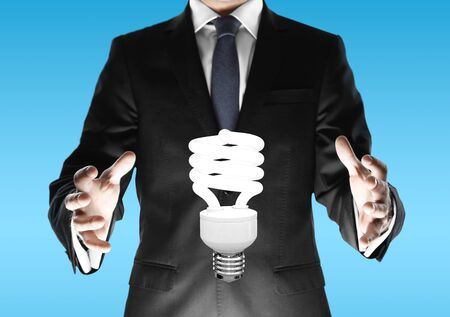 businessman and energy saving lamp Stock Photo - 18560465