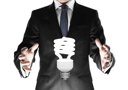 businessman and energy saving lamp Stock Photo - 18560456