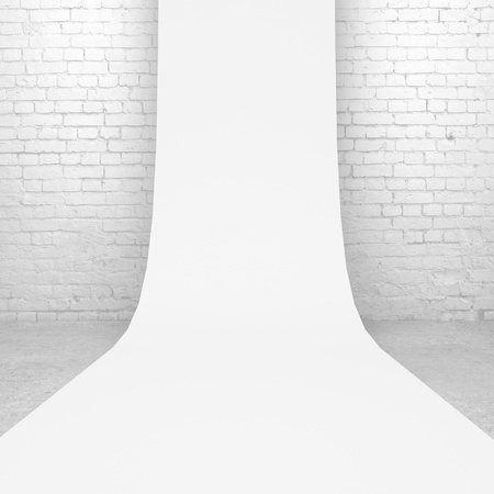 White backdrop in brick room photo