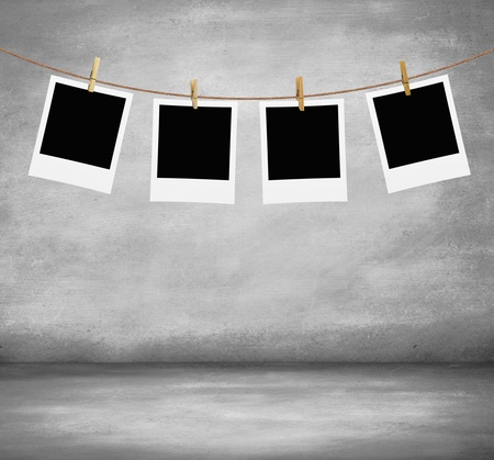 recollection: four photos hanging on a rope in concrete room Stock Photo