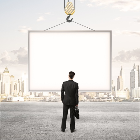 billboard blank: businessman looking at blank billboard Stock Photo