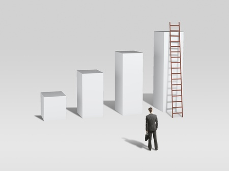 businessman looking at column and ladder photo